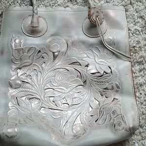 Large off white cut out bag